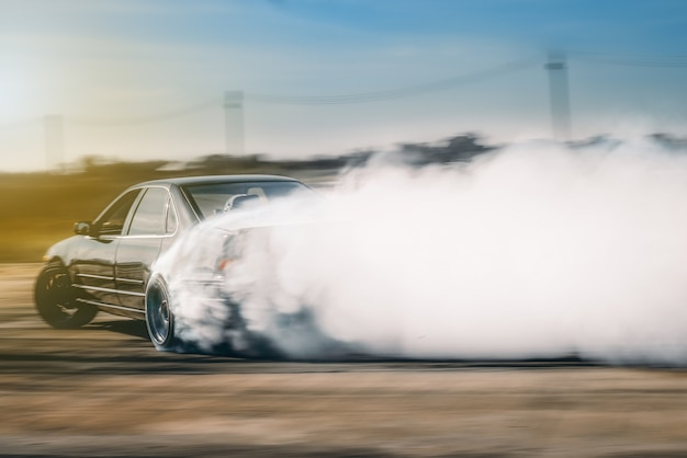 Drift driving is approaching the high speed curve and has a lot of smoke.