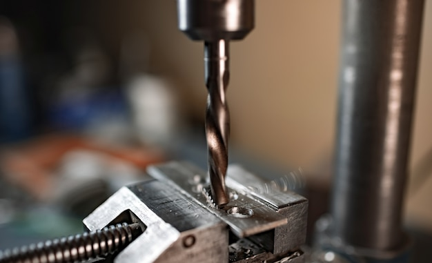 Drill close-up, drilling machine at the workplace of a toolman locksmith