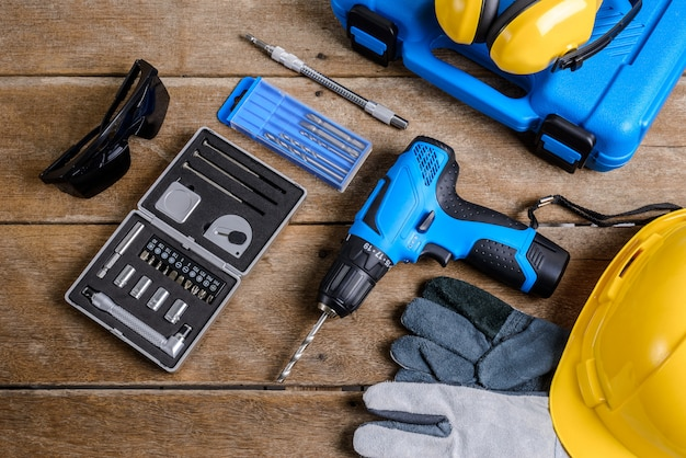 Drill and set of drill,tools,carpenter and safety, protection equipment
