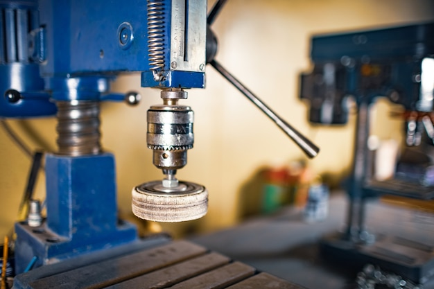 Drilling machine at the workplace of a toolman locksmith