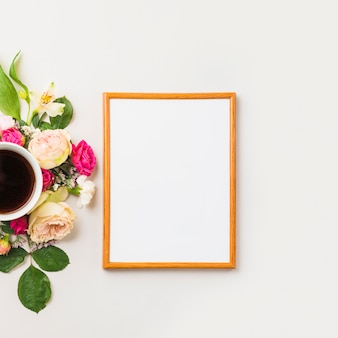 Drink and flowers near frame