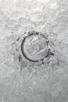 Drink can iced submerged in frost ice closeup