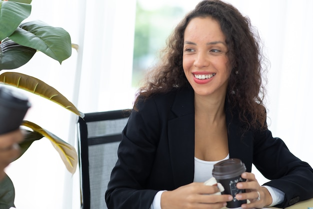 Drink coffee. hispanic business woman busy working laptop computer at office.