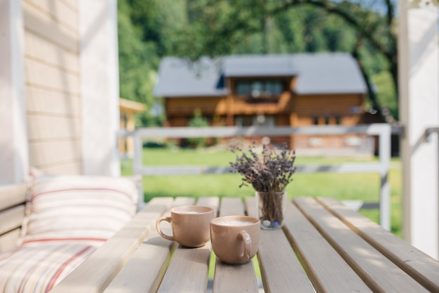 Drink coffee and relax on the veranda in the summer