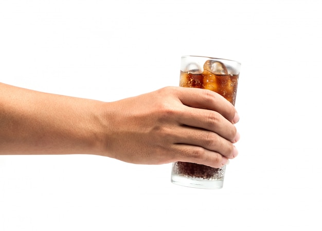 Drink cola in glass with hand on white background.