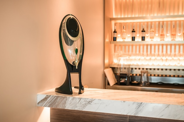 Drink, equipment and object concept - close up of draft beer kegerator tower at bar or pub