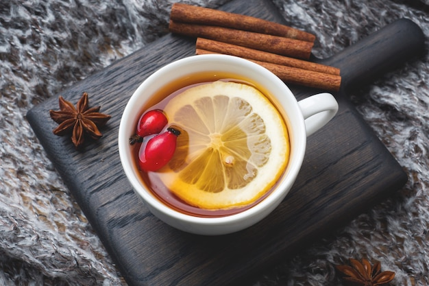 Drink from wild rose berries with lemon and honey cinnamon.