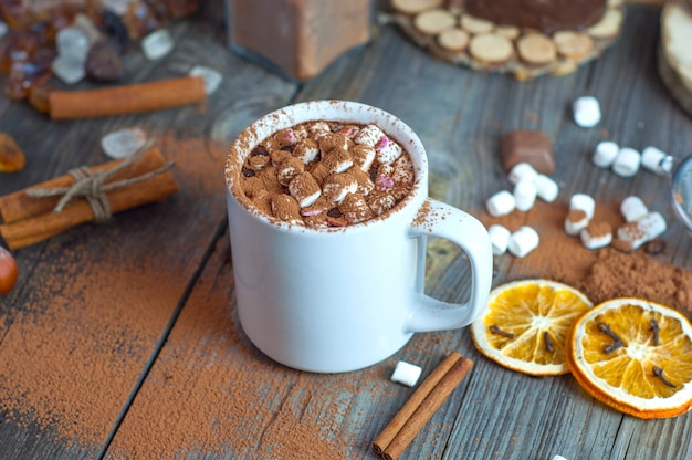 Drink hot chocolate with marshmallows in a white cup