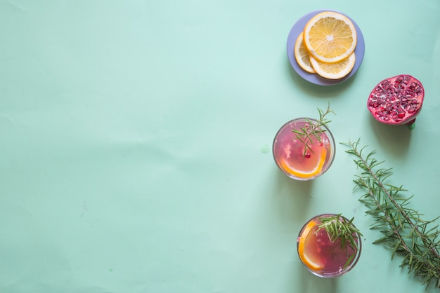 Drink of pomegranate, rosemary and orange