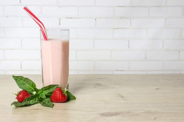 Drink smoothies summer strawberry with mint on wooden table.