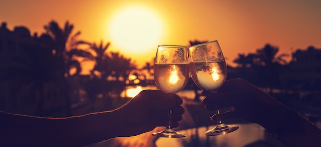 Drink wine by the sea.