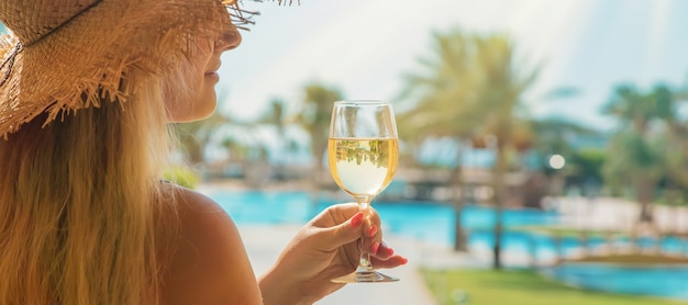 Drink wine close to the swimming pool