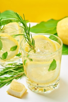 Drink with lemon and rosemary on table