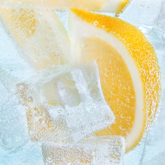 Drink with slices of lemon and ice. soda cocktail tonic.