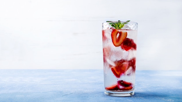 Drink with strawberry, lime, and mint, summer lemonades mojito cocktails