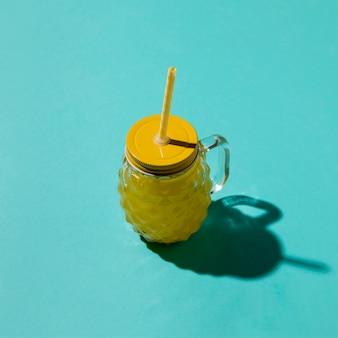 Drinking jar with lemonade on blue background