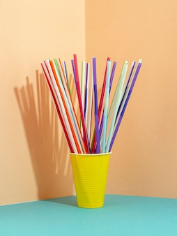 Drinking straws on colorful background