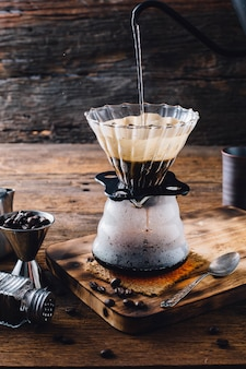 Drip coffee on wooden table