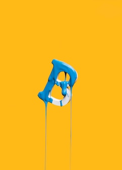Dripping paint on letter b