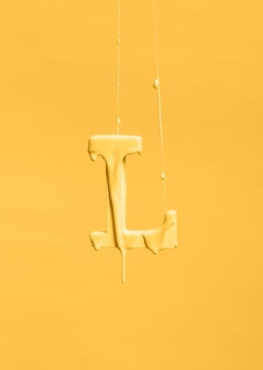Dripping paint on letter l