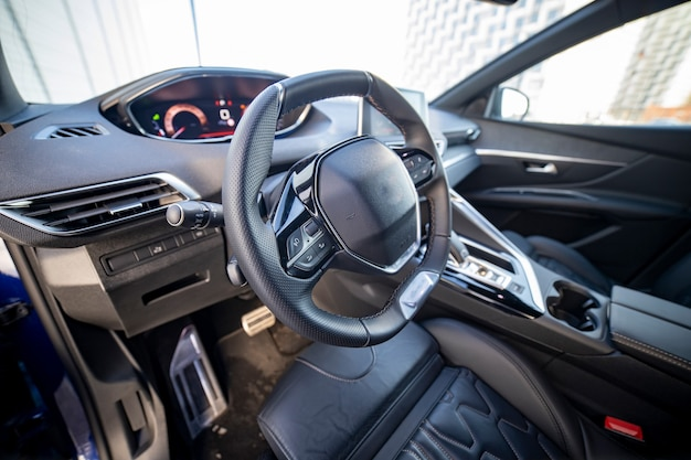 Driver's seat and steering wheel interior of modern fashionable car
