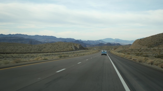 Driving auto, route to las vegas, nevada usa. road trip from grand canyon, arizona. hitchhiking traveling in america, wild west indian lands, desert and mountains journey. wilderness thru car window.