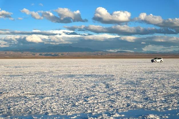 Driving on salar de uyuni or uyuni salts flats, bolivia, south america