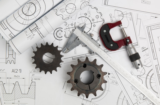 Driving sprockets, caliper, micrometer and engineering drawings of industrial parts and mechanisms