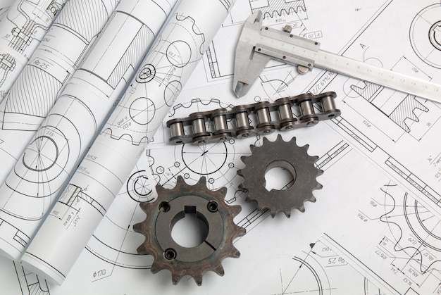 Driving sprockets, chain and engineering drawings of industrial parts and mechanisms