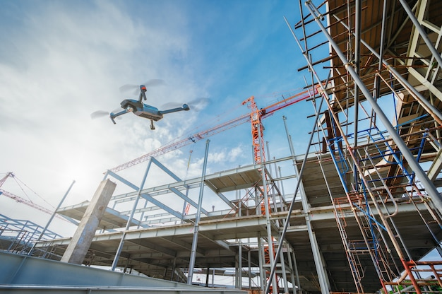 Drone over construction site for surveillance or industrial inspection