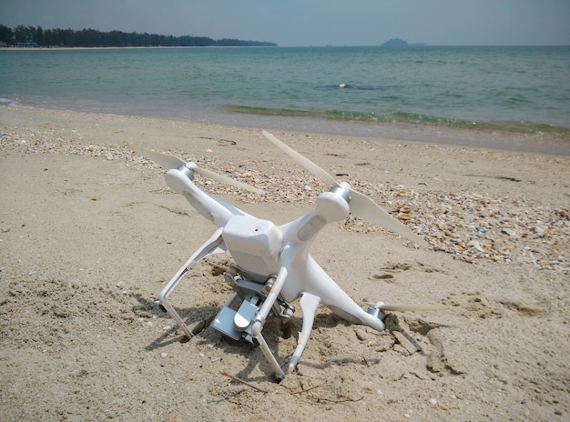 Drone fallen from sky to sand beach
