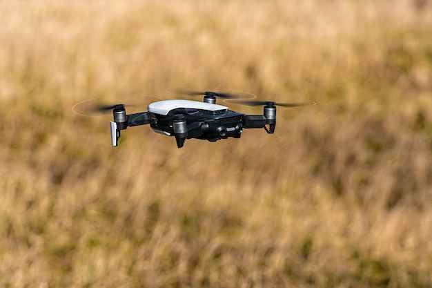 Drone flying over agricultural field in spring, technology innovation in agricultural industry