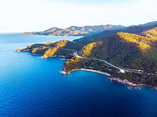 Drone panorama of sunset in halkidiki with blue sea and mountains, greece
