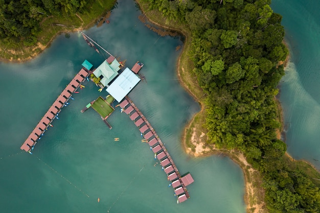 Drone photo of the lake and trees of the khao sok national park during daytime