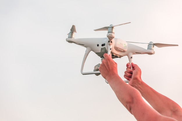The drone and photographer woman hands