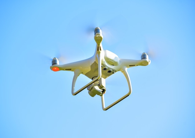 Drone quad copter with digital camera on the sky