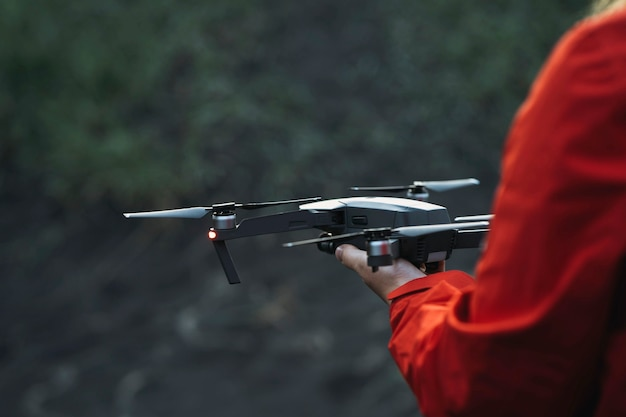 Drone ready to fly off a hand