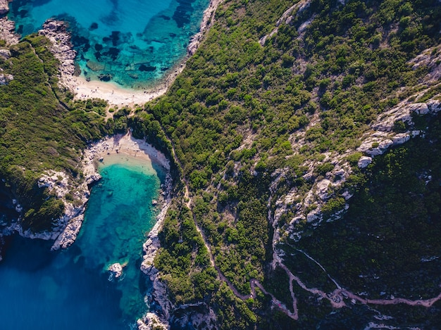 Drone shot of breathtaking shore of porto timoni with deep tropical blue and clear turquoise sea