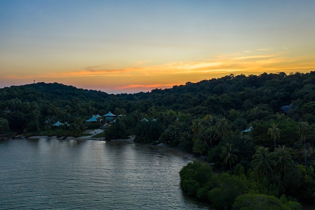 Drone shot the luxury but eco community resort and hotel on the mountain in kohkood island