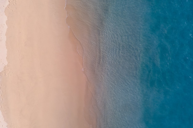 Drone shot perspective of the sea shore with the sand