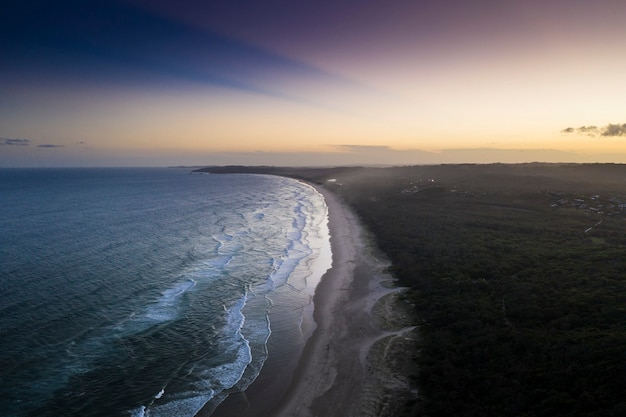 Drone view of coastline in the early morning Free Photo