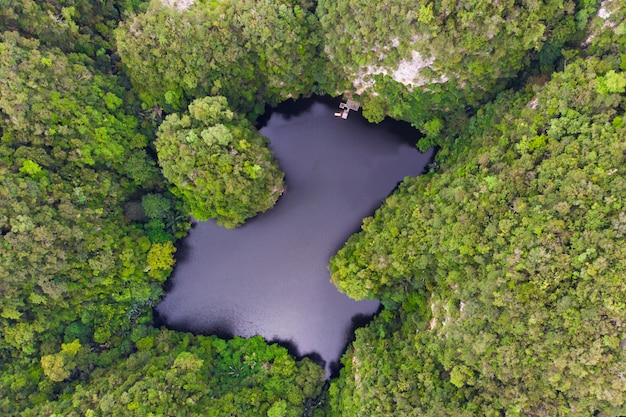 Drone view of lake where is called as mirror lake in ipoh, malaysia