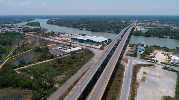 Drone view top down of tapee river and bridge in surat thani thailand.