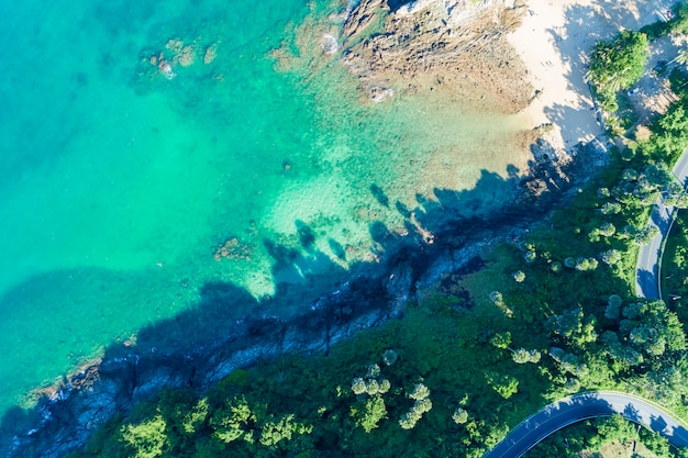 Drone view top view landscape nature scenery view of beautiful tropical sea with sea coast view in summer season image by aerial view drone shot