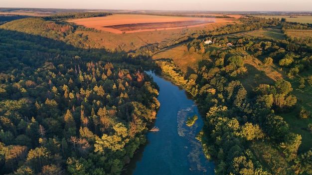 Drone with a camera, beautiful summer small river from a height