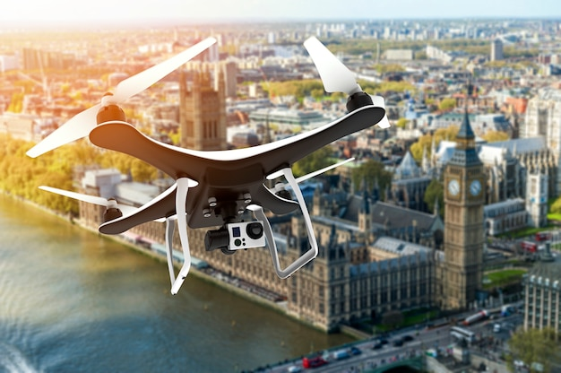 Drone with digital camera flying over london