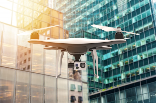 Drone with digital camera flying over a modern city