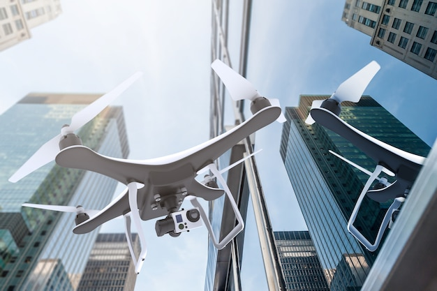 Drone with digital camera flying near modern skyscrapers
