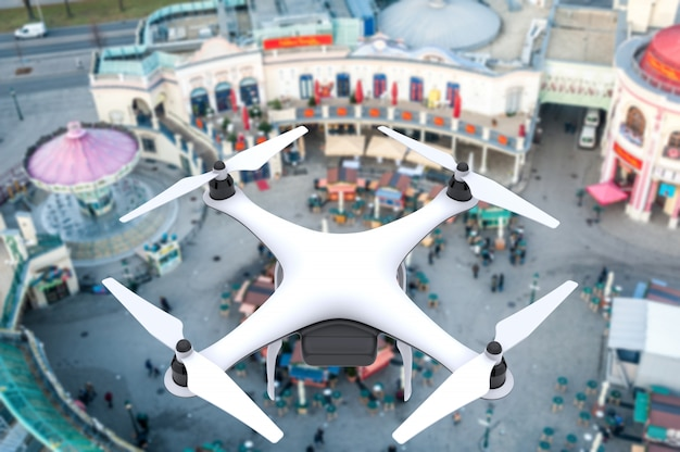 Drone with digital camera flying over a square