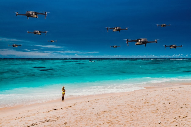 Drones fly over the beach of a tropical island in the indian ocean. a natural landscape with drones flying over it. quadrocopter